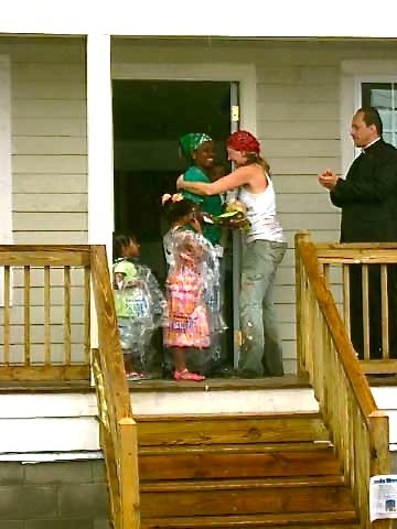 Amy congratulating the new homeowners of a Habitat for Humanity build post-Katrina in New Orleans, LA.